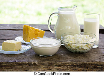 Dairy products on wooden table, selective focus, shallow deep of field