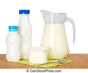 Dairy products - On a napkin from a bamboo milk in a jug,...