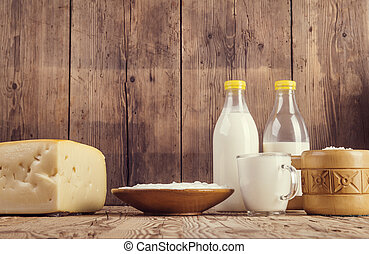 Dairy products - Variety of dairy products laid on a wooden...