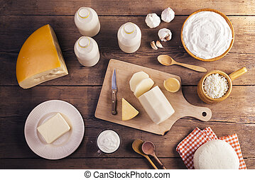 Dairy products - Variety of dairy products laid on a wooden ...