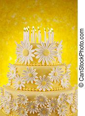 Daisy birthday cake - Three tier fondant cake with candles...