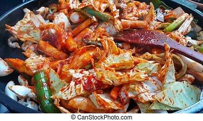 Dak galbi, traditional Korean food preparation. Fried chicken with spice sauce and vegetable. Chuncheon, Korea Dakgalbi, sort of chicken food