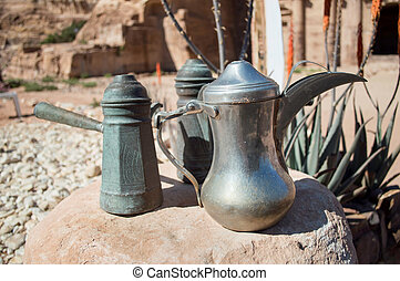 dallah is a metal pot with a long spout designed specifically for making Arabic coffee