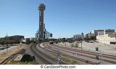 Dallas Train - Commuter Train in front of Reunion Tower in...
