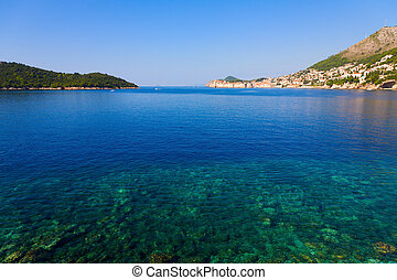 Beautiful view on Dubrovnik with clear turquoise water in the foreground