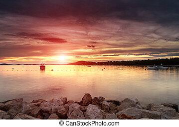 Dalmatia sunset in bay - Sunset over an island bay in ...