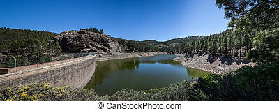 Dam on mountains - Dam between the mountains under a blue ...