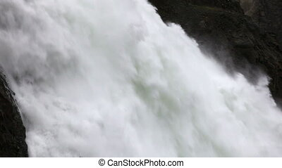 Dam spillway hydropower - Water falling from a spillway at...