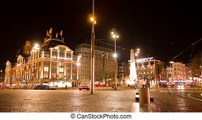 Dam Square at night. Amsterdam, The Netherlands. Time Lapse.