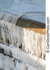 Dam wall is covered with frost in winter the lake