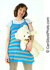 dama, embarazada, con, teddybear