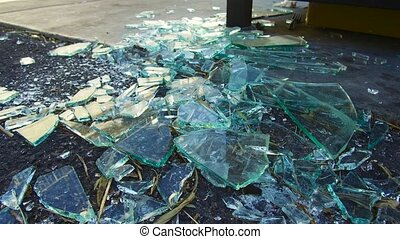 shards of broken glass on floor - damage concept - shards of...