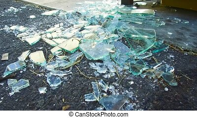 shards of broken glass on floor