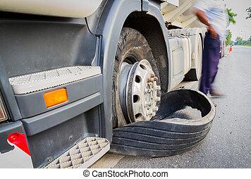 Damaged 18 wheeler semi truck burst tires by highway street,...