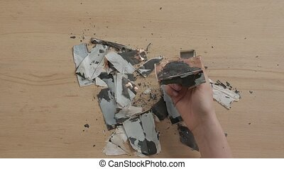 Damaged battery parts cut magnet unrecognizable man hands top table view