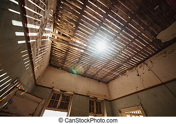 Damaged Building Roof with sunlight shinigh through