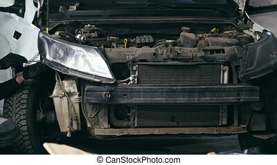 Damaged car in workshop garage - automobile service, wide...