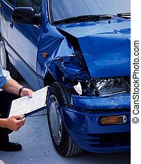 damaged car - surveyor at a blue damaged car after an...