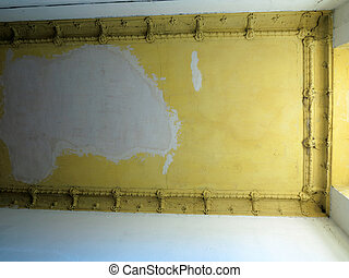Damaged ceiling in an old abandoned home