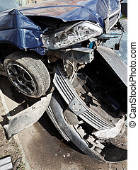 damaged hoods of cars during road accident