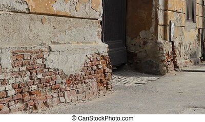 Damaged Masonry - Pan shot with masonry and brick foundation...