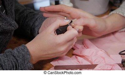Damaged nail polish base sore woman hands closeup