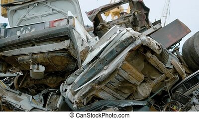 Damaged old cars stacked on big junkyard of recycling...