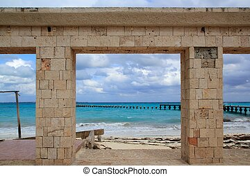 damaged pier and beach after hurricane tropical