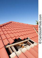 Damaged red tile roof construction