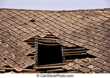 Old collapsed roof on a house. Polish countryside.