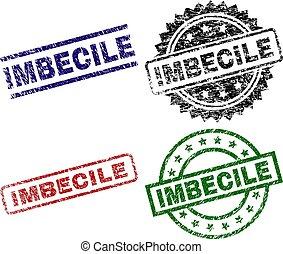 Damaged Textured IMBECILE Stamp Seals - IMBECILE seal prints...