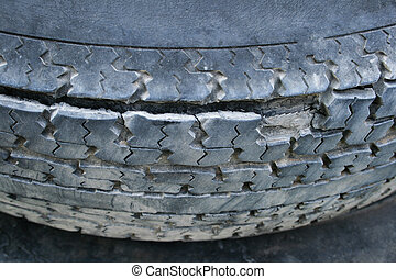 damaged steel belted radial tires with delaminating, peeling, and exposed belts