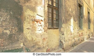 Damaged wall and windows. Old cement and bricks. Decades go...