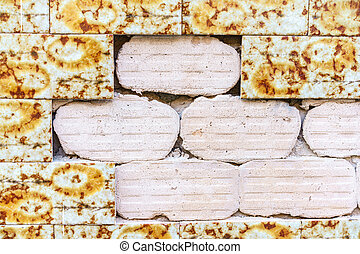 Damaged wall with ceramic tiles