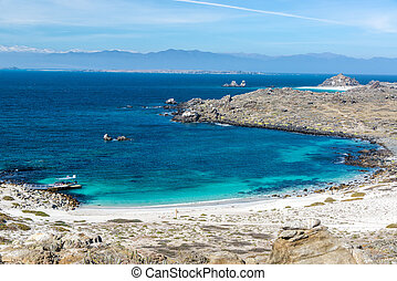 White sand and turquoise and blue water at Damas Island in Chile