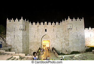 Damascus Gate entrance Old City Jerusalem Palestine Israel night light long exposure motion blur faces