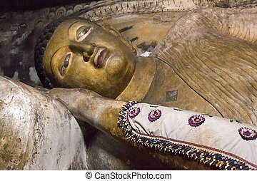 Big golden Buddha statue inside of Dambulla cave temple