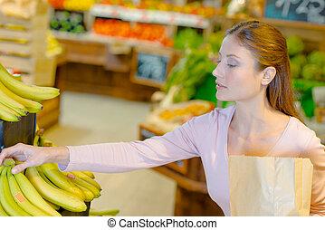 dame, bananen, aankoop