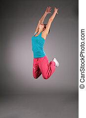 dançar, mulher, em, sportswear, em, salto, com, rised, mãos