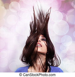 Dance and party concept - woman with hair in motion