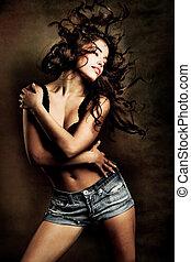 attractive long hair brunette dancing, studio shot