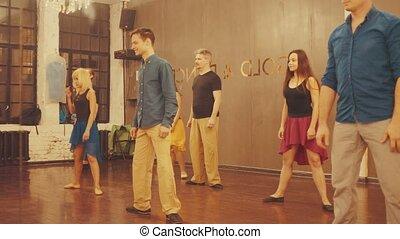 Dance classes. Dance students doing exercises, 4K