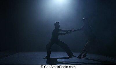 Dance element from the Latin American program, silhouette couple ballroom