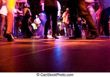 Dance Floor - A low shot of the dance floor with people ...