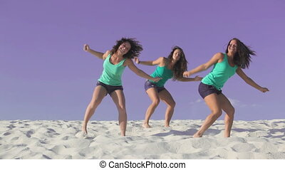 Dance - Beautiful women dancing on the sand together