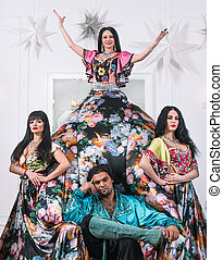 dance group in Gypsy costumes posing on stage