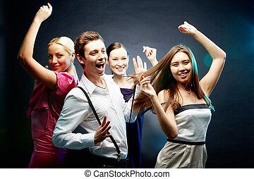 Dance movements  - Four joyful friends dancing together