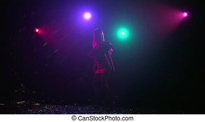 Dance of silhouette girl with disco style lights. Slow motion