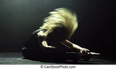 Dance on the floor - Blond long-haired female performing...