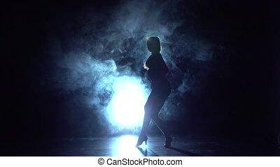 Dance performed by charming girl, backlit haze. Slow motion...